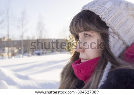 Beautiful girl and sunny winter