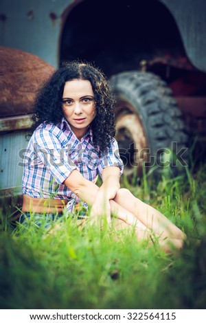 Beautiful girl and the rustic - stock photo