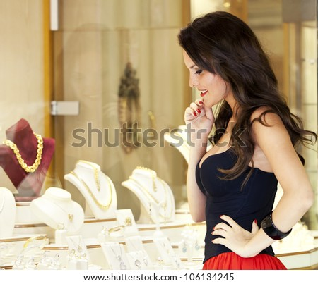 beautiful girl at a jewelry shop - stock photo