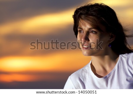 beautiful girl at the sunset - stock photo