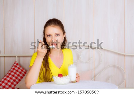 beautiful girl at the table eating cheese - stock photo