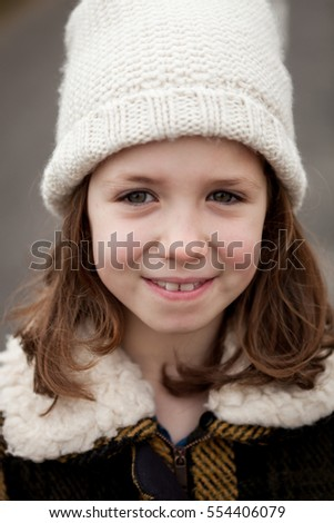 Beautiful girl back with wool hat at winter in the street