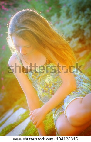 beautiful girl bathed in sunlit - stock photo