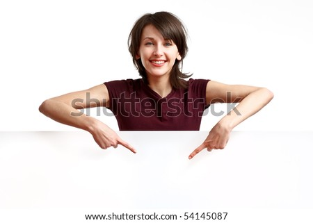 beautiful girl behind an empty white board pointing her fingers down - stock photo