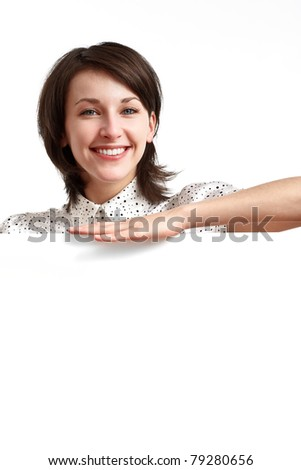 beautiful girl behind empty board smiling and pointing her fingers down - stock photo
