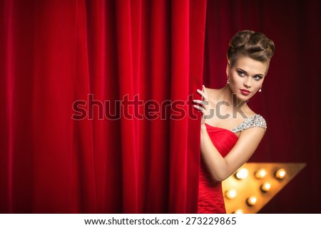 Beautiful girl behind the curtain - stock photo