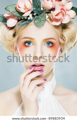 Beautiful girl blonde supermodel  in wreath of flowers closeup portrait. Series of photos - stock photo