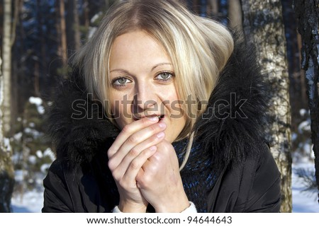 beautiful girl blonde warm hands in the winter in nature - stock photo