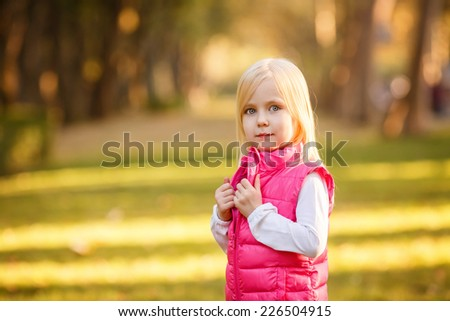 Beautiful girl blowing soap bubbles in the park