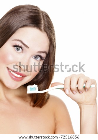 Beautiful Girl Brushing her Teeth, isolated on white background. - stock photo