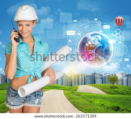 Beautiful girl builder in helmet holding paper scrolls and talking on phone. Green hills, road, city and flying virtual elements as backdrop. Elements of this image furnished by NASA - stock photo
