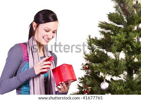 Beautiful Girl by the Christmas Tree - Isolated - stock photo