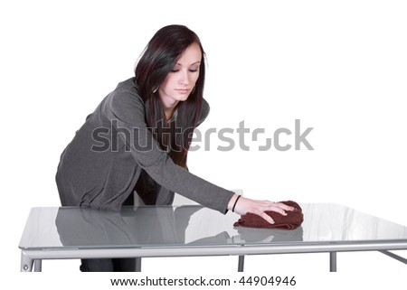 Beautiful Girl Cleaning Kitchen Table - Isolated Background - stock photo