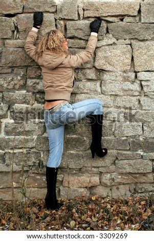 Beautiful girl  climbing up the wall
