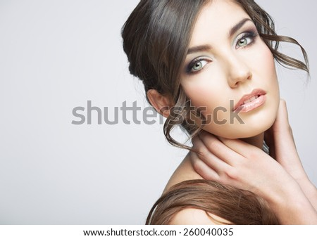 Beautiful girl close up face portrait with long hair style. Female model studio posing.