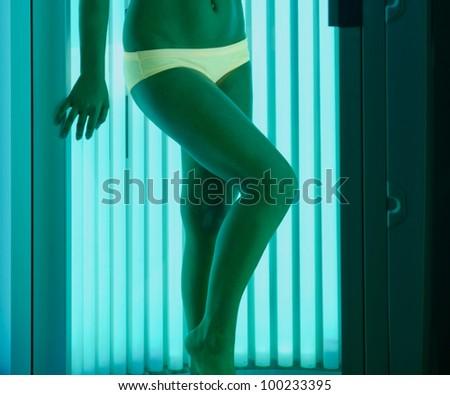beautiful girl closeup in swimsuit at solarium - stock photo