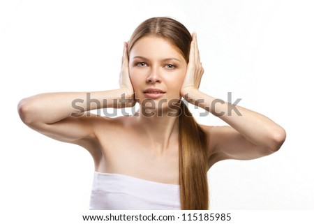 beautiful girl closing ears isolated on white - stock photo