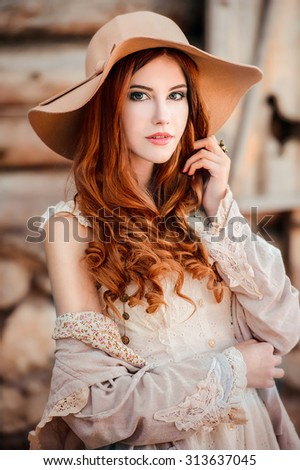 Beautiful girl clothing style boho in autumn outdoor. Woman in hat - stock photo