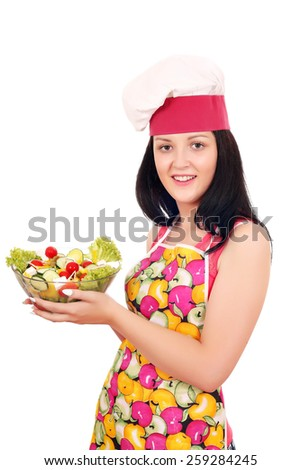 beautiful girl cook holding dish with salad