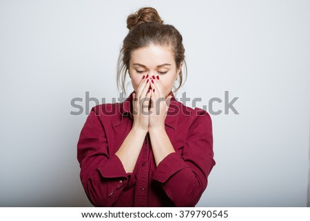 Beautiful girl covers his nose from the smell, isolated on a gray background - stock photo