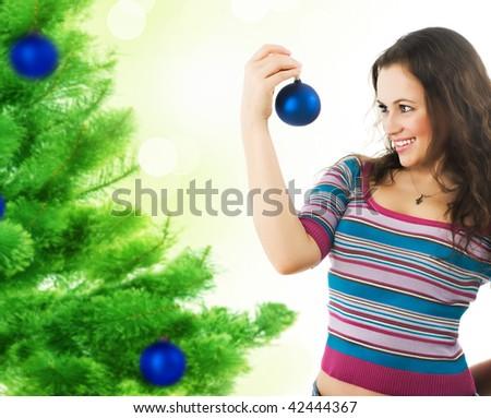Beautiful Girl  decorating a Christmas tree - stock photo