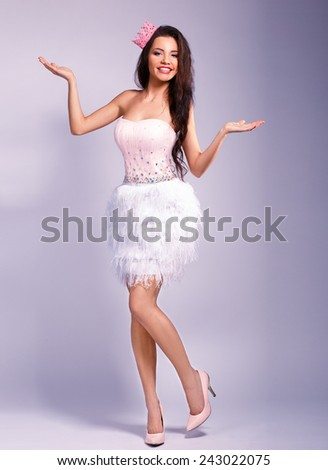 beautiful girl dressed as a princess shows your text - stock photo