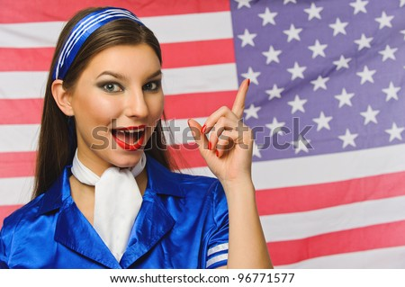 beautiful girl dressed as flight attendants on an American flag background
