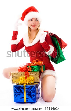 beautiful  girl dressed as Santa with Christmas presents - stock photo