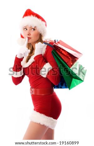 beautiful girl dressed like Santa with Christmas presents - stock photo