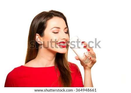 Beautiful Girl Drinking a Glass of Pure Water Smiling Holding on White - stock photo