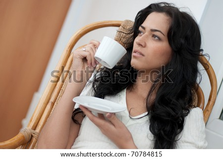 Beautiful girl drinking coffee - stock photo