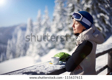 beautiful girl drinking coffee in the mountains - stock photo