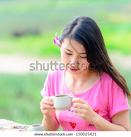 Beautiful Girl Drinking Healthy Green Tea. Healthcare or Herbal medicine concept - stock photo
