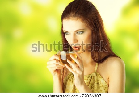 Beautiful Girl Drinking Healthy Green Tea. Healthcare or Herbal medicine concept