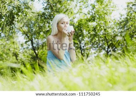 Beautiful Girl Drinking Healthy Tea. Healthcare or Herbal - stock photo
