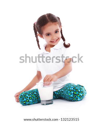 beautiful girl drinking milk with cookies over white background