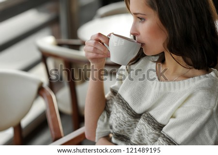 beautiful girl drinking tea, coffee - stock photo