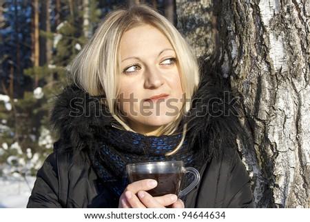 beautiful girl drinking tea in winter, in nature - stock photo
