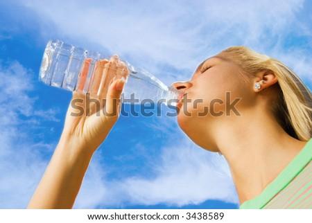 Beautiful girl drinking water - stock photo