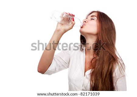 Beautiful  girl drinking water isolated on white