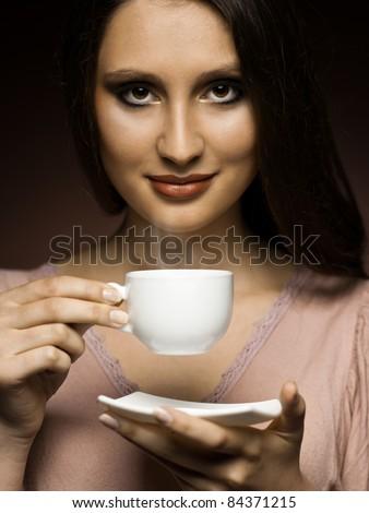 beautiful girl drinks coffee in the kitchen - stock photo