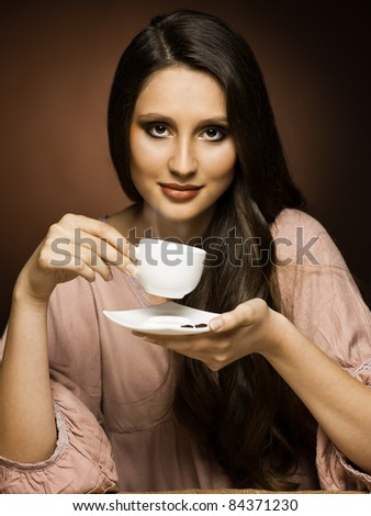 beautiful girl drinks coffee in the kitchen - stock photo