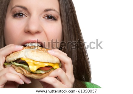 Beautiful girl eating hamburger food