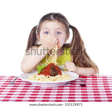 Beautiful girl eating pasta and meatballs with hands - stock photo