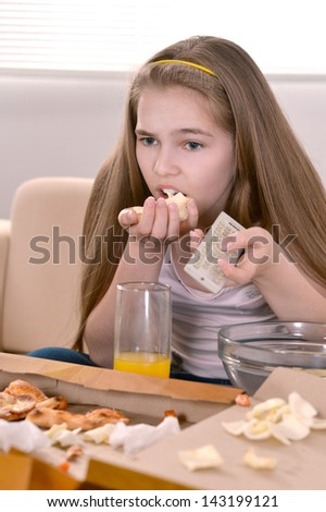 beautiful girl eating pizza at home