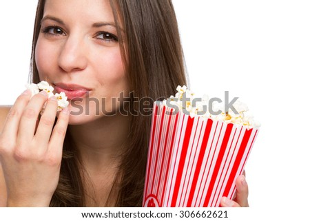 Beautiful girl eating popcorn on white background - stock photo