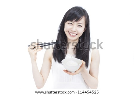 Beautiful girl eating rice with chop sticks, isolated on white background - stock photo