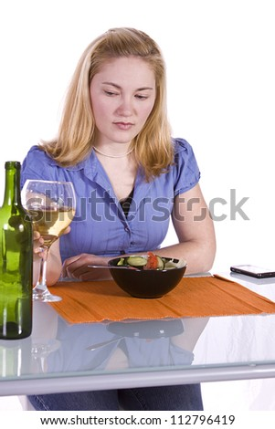 Beautiful Girl Eating Salad and Drinking Wine - stock photo