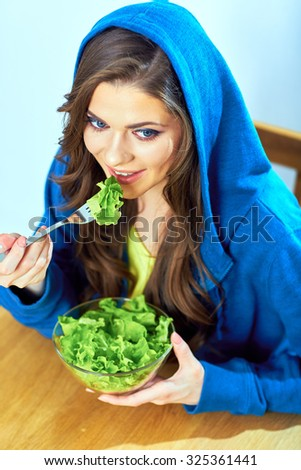 beautiful girl eating salad. female portrait. vegetarian diet. - stock photo