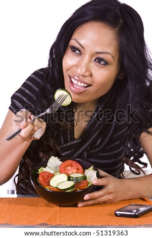 Beautiful Girl Eating Salad - Isolated Close up - stock photo